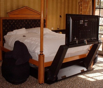 underbed lift a television that is hidden under the bed teched out. Black Bedroom Furniture Sets. Home Design Ideas